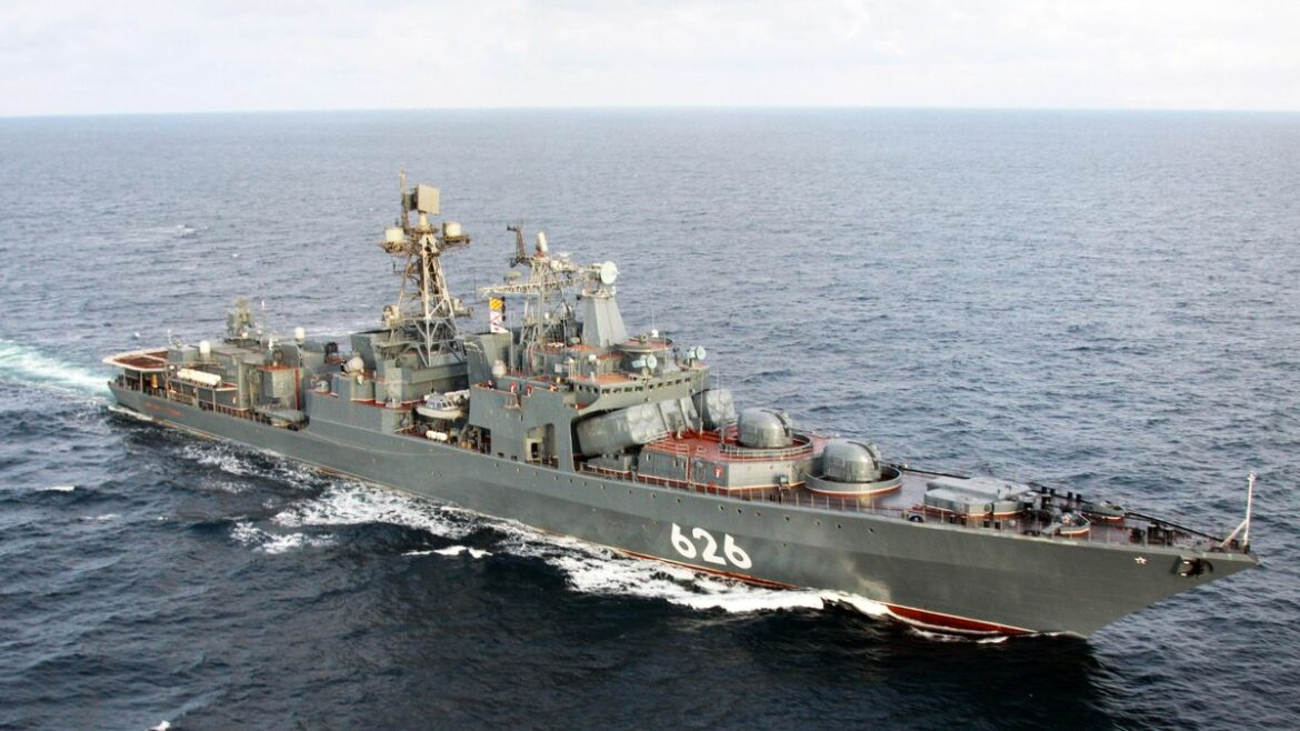 Russian anti-submarine destroyer cruises into English Channel with support fleet