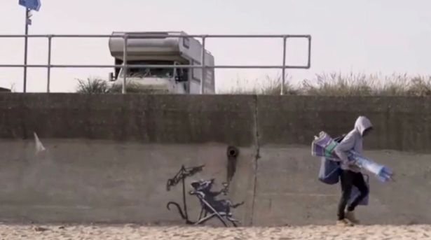 Banksy filmed in the act as he confirms mystery art in seaside towns is genuine